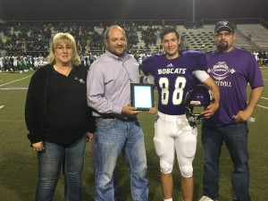 Hallsville's Brett Gibson (middle right) Dave Campbell's Texas Football Unsung Hero Award presented by Texas Farm Bureau Insurance from TFBI agent Brian Brazil (middle left).