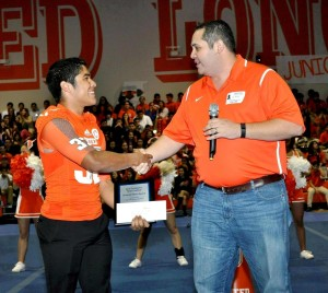 Laredo United's Alexis Villanueva (left) receives the Dave Campbell's Texas Football Unsung Hero Award presented by Texas Farm Bureau Insurance from TFBI agent JuanCarlo Rendon (right).