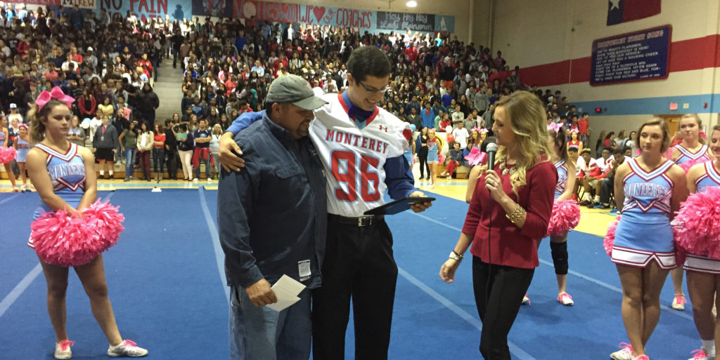 Lubbock Monterey's Tommy Calvillo — standing his father, Daniel — is awarded the Unsung Hero Award from Amy Riggan of Texas Farm Bureau Insurance at a Monterey pep rally.